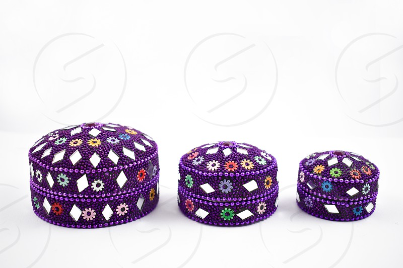 Oriental decorative box. Set of purple boxes on a white background. Decorated gift box photo