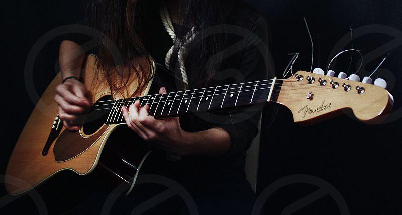 A guitar player photo