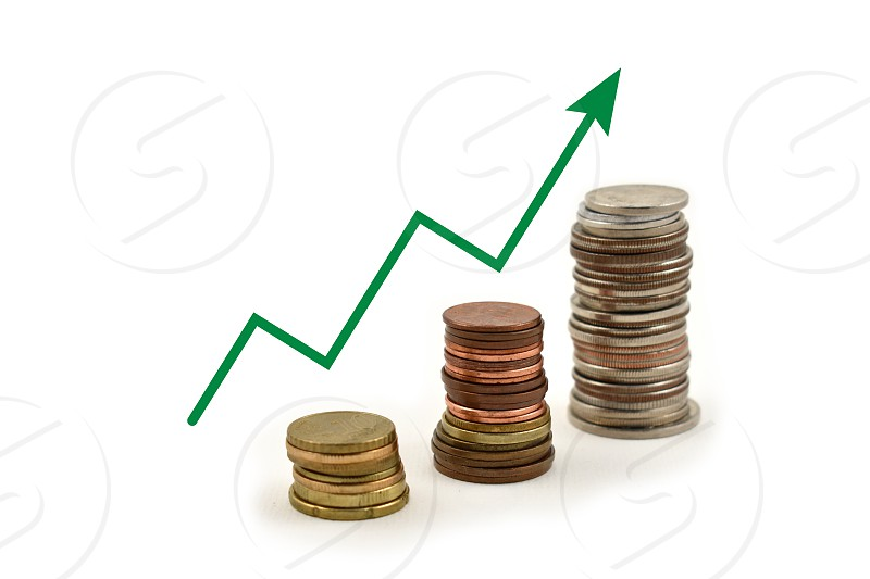 Money graph. Coin stack images. Different coins on a white background. Different types of currencies photo